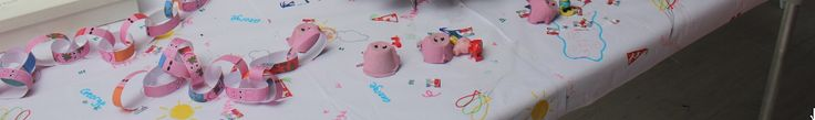Peppa Pig Table Cloth. I could not find what I wanted so I made my own. You will need white paper table cloths and coloured pens. Doodle away. It looked awesome