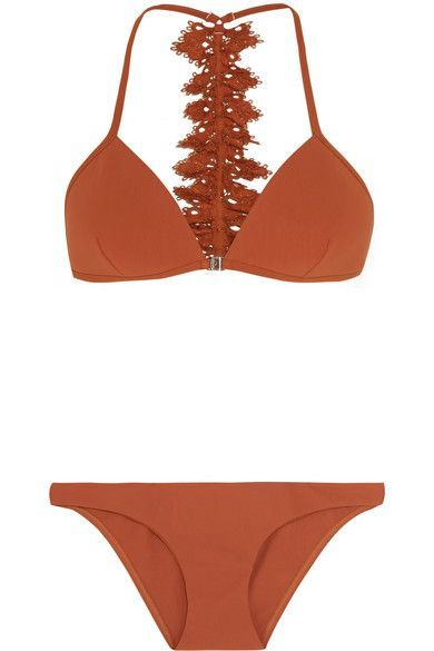 Zimmermann's bikini turns to reveal a ruffled broderie anglaise trim - woven with gold threads that shimmer in the light. Crafted from smoothing stretch fabric, it has lightly padded triangle cups and briefs that offer full coverage at the back. The copper hue will complement sun-kissed skin perfectly.