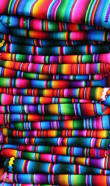 The bright colours in these mexican blankets would compliment an array of grey tones.
