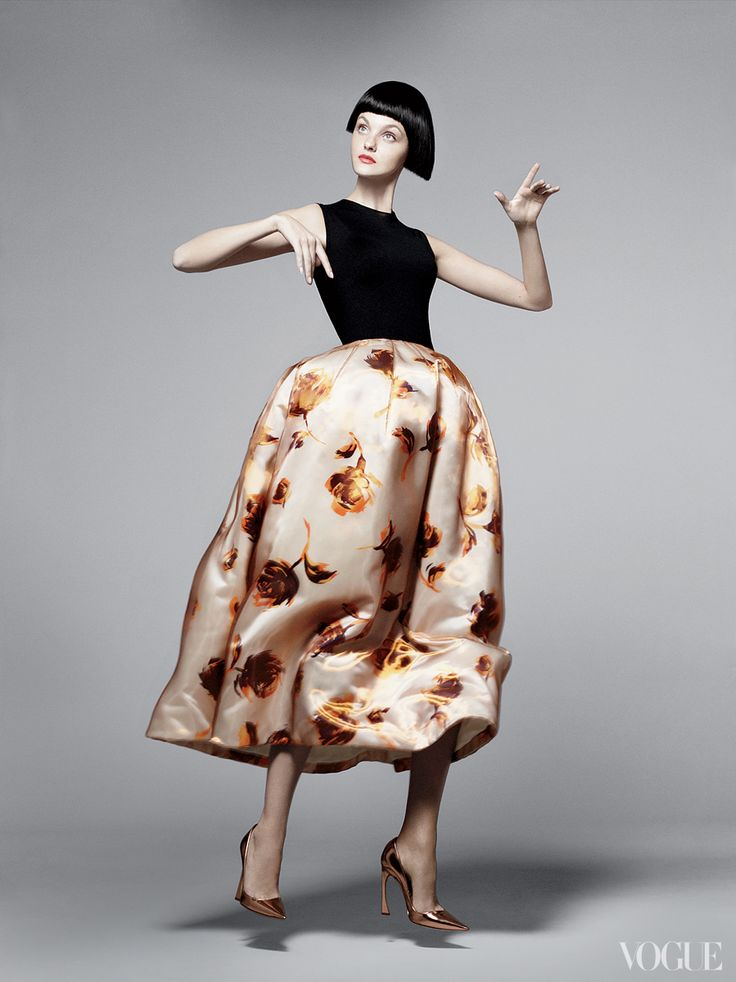 Simons catapults the codes of Dior into the present with a voluminous silk–duchesse satin skirt adorned with roses for spring. Dior cashmere-and-silk sleeveless top ($960), silk-duchesse satin skirt, and pumps; Dior boutiques.