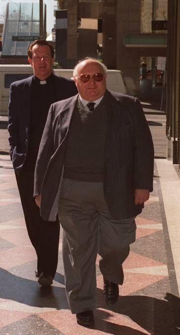 Former parish priest of Edmund Rice, Father Peter Comensoli (front), served 18 months' jail for sex abuse offences.