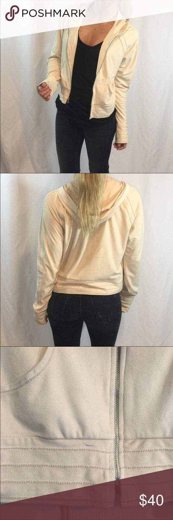 Cream Super Soft Suede Bebe Zip Up Hoodie Super soft suede Bebe zip up hoodie. Cream color. Pen mark on front as shown in photos. Overall good condition. No tags at all. Fits like an XS/S (I'm 5'1, 120 lbs for reference). Such a cute piece! bebe Sweaters