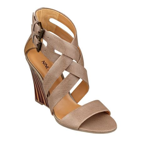 Mauren strikes the perfect balance between sophisticated and sexy. Crisscrossing straps and dual buckle closure. Padded footbed for all-day comfort. Leather upper. Man-made lining and sole. Imported. Stacked 3 3/4 inch stacked heels. Women's shoes. Wedge sandals.