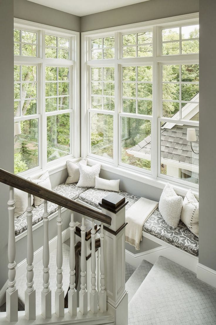 Window seat on staircase landing. LOVE having tons of windows for the natural light.