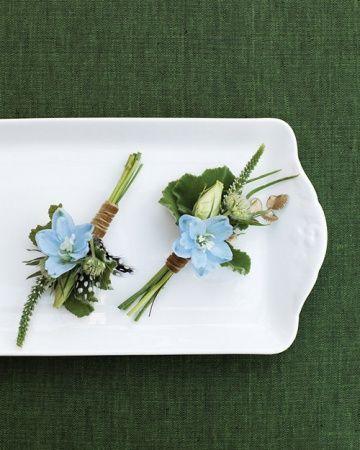 light-blue delphinium, lisianthus buds, geranium foliage, veronica tips, and button ferns