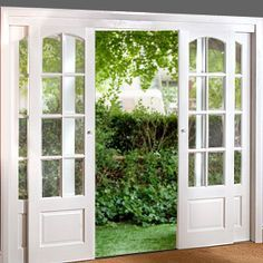 These would be great to replace my glass sliding door with! So want this!!!! Sliding French Doors--I like this idea. combining the sliding barn door look with the class of french doors.