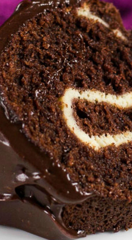 Cheesecake Swirl Chocolate Bundt Cake ~ Deliciously moist and fluffy chocolate Bundt cake, swirled with a thick and creamy vanilla cheesecake centre!
