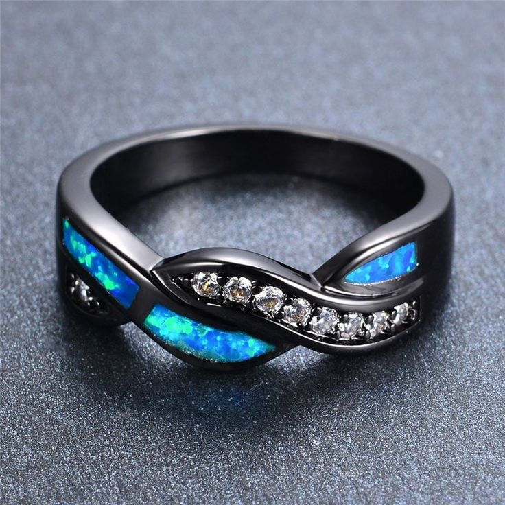 This luxury ring is accented with crystal studs and fire blue opal intertwined with each other. It is the perfect everyday ring that will complement any type of outfit. It is also a great friendship r