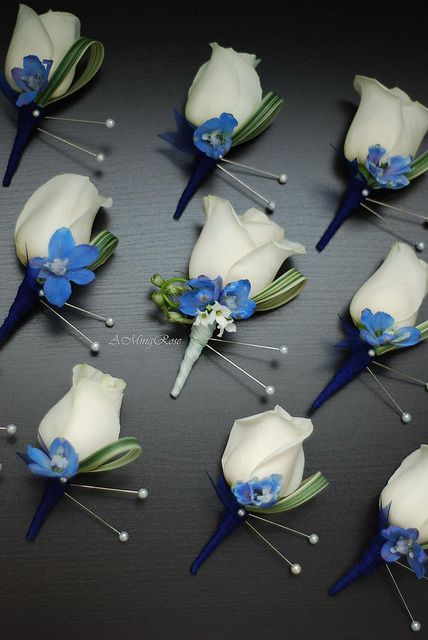 White Rose and Blue Delphinium Boutonnieres