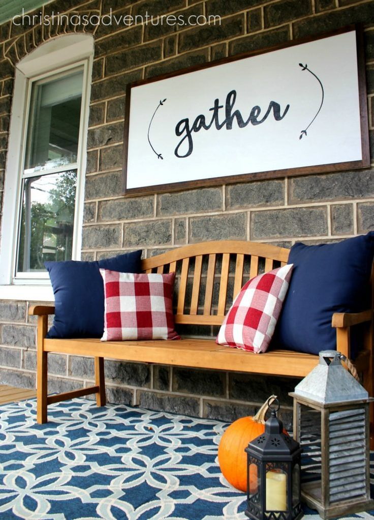 welcoming fall front porch bench - such an incredible porch!