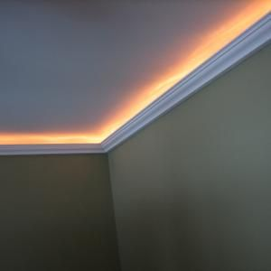 Indirect lighting (or rope lighting) installed in a bedroom. Install a dimmer switch for varying accents and moods -- A really nice touch when installing crown molding.
