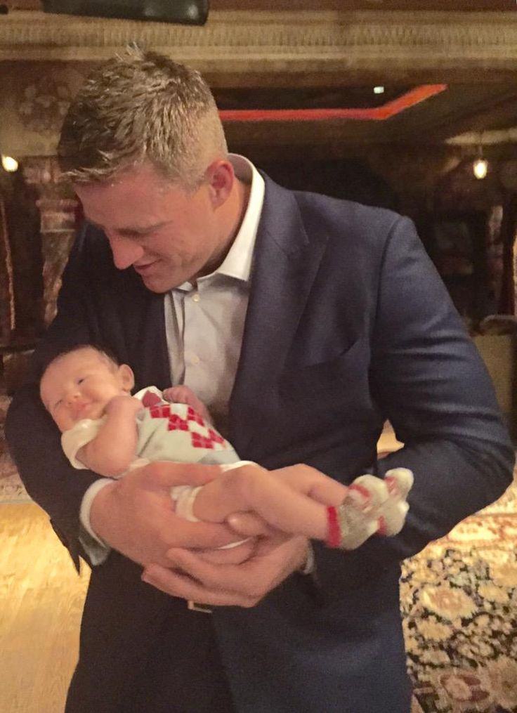 JJ watt our vp, power relations holding reliant's new lil' mascot - my precious Finley!!  watt a guy