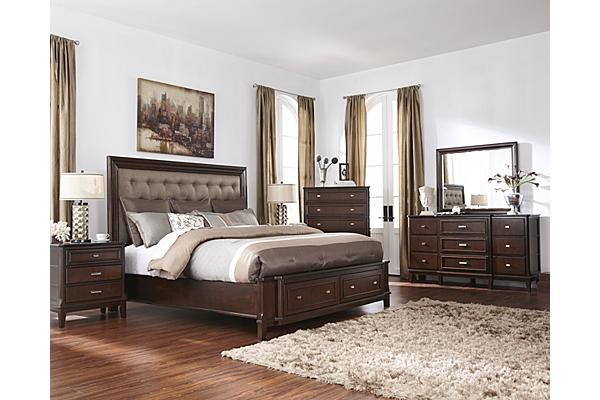 """The Larimer Panel Bedroom Set from Ashley Furniture HomeStore (AFHS.com). With a dark espresso finish flowing beautifully over the birch veneers and Asian hardwoods, the rich contemporary style of the """"Larimer"""" bedroom collection features fabric upholstered headboards adorned with button tufting details along with the function of a storage footboard."""