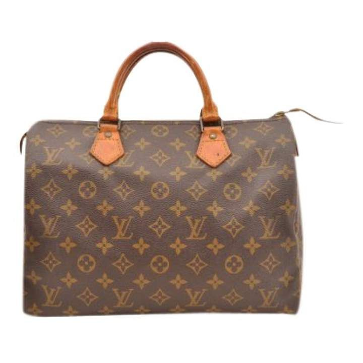 b56cb557bf00 ShopStyle Collective Louis Vuitton Speedy