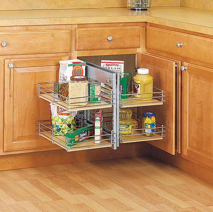 a front set of shelves slide out and to one side allowing a second set