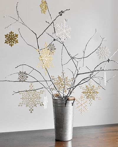 seasonal branch centerpiece with glittery snowflakes for winter