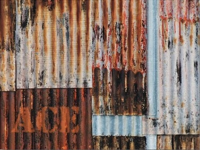 Weathered corrugated metal, rust creates interesting patterns and rustic colours