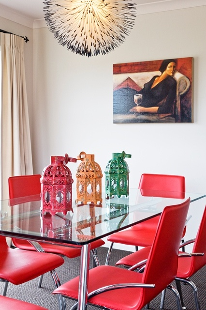 Old 'n' new. Modern red chairs and vintage lanterns, anything goes in this funky dining room.