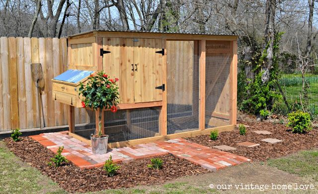 Oh my goodness, what a great set up for a chicken coop! The box on the end is where they collect the eggs so there's no fear of getting your eyes pecked out by a cranky roosting hen! :) Her site has other amazing ideas as well
