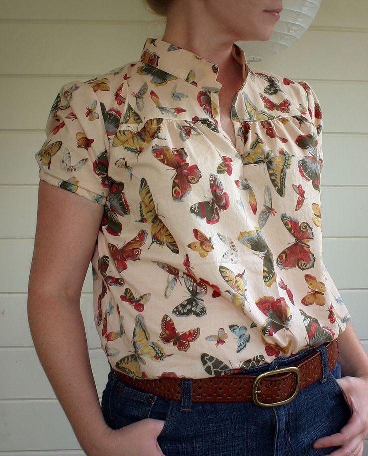https://flic.kr/p/8A4uAt | butterfly blouse | I think I've decided that I like this blouse, even though the fabric is a bit much. :) I made it little too big, though. The fabric is an Alexander Henry cotton lawn and the pattern is Neue Mode #23489, view C.