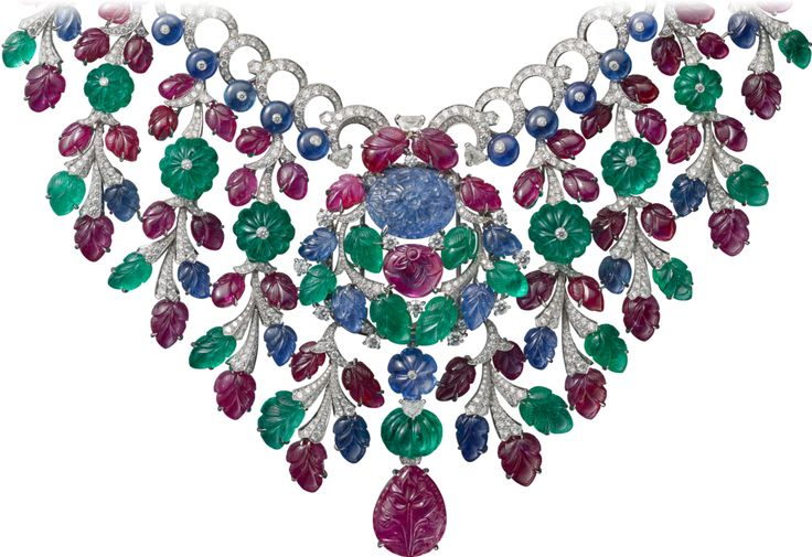 "CARTIER. {Close up} ""Rajasthan"" Necklace/Brooch - platinum, one 16.40-carat carved sapphire from Burma, one 22.61-carat carved pear-shaped ruby, carved rubies, sapphires and emeralds, sapphire beads, one melon cut sapphire and seven melon cut emerald beads from Afghanistan, kite-shaped diamonds, brilliant-cut diamonds. #Cartier #CartierMagicien #HauteJoaillerie #FineJewelry #CarvedStones #TuttiFrutti #Emeralds #Rubies #Sapphires #Diamonds"