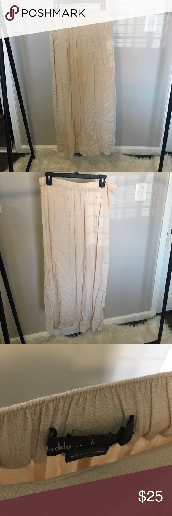 Tan Maxi Skirt w/ Pockets This is the go to maxi skirt. You can dress it up or down depending of the occasion. The pockets make it very comfortable to wear. Skirts Maxi