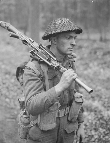 Private H. E. Goddard of Perth Regiment of the Canadian 5th Armored Division near Arnhem, Netherlands, 15 Apr 1945. (National Archives of Canada)