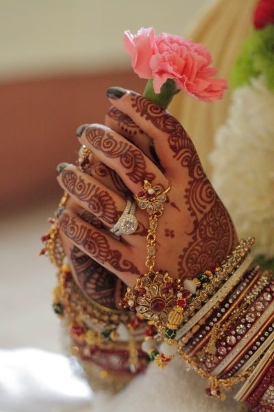 Indian bride's henna designs and jewelry.