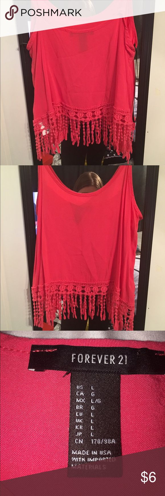 Hot pink tank top, lace At bottom Hot pink tank top, cotton fabric. Thin spaghetti straps and lace fringe at bottom! Forever 21 Tops Tank Tops