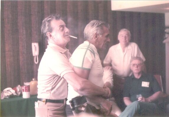 Luz gives Guarnere a big hug at the E Co. reunion in Chicago, 1992. Red Wright and Leo Boyle are in the background.