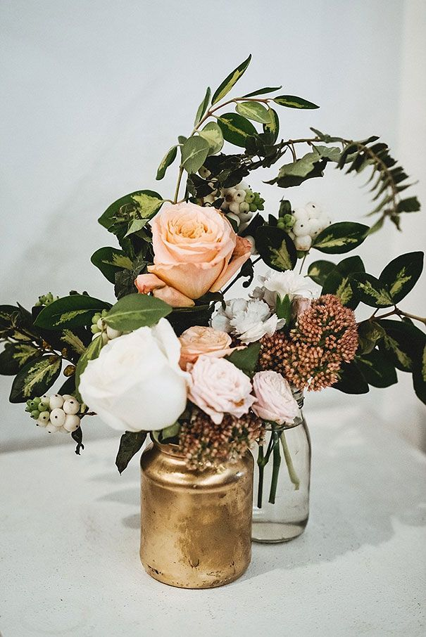 I think floral decor will be key. We can easily spray paint little jars to incorporate your color themes