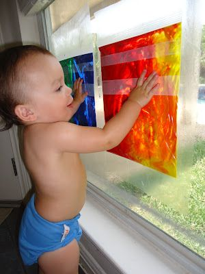 "What a great less-mess idea to entertain little people! Put non-toxic paints in Ziploc-style bags. Tape bags up on windows at a reachable height, then show them how to ""finger paint"" and have fun!"