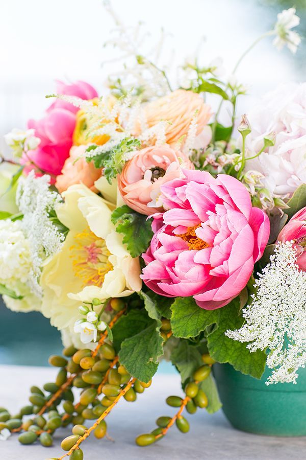 Gorgeous flowers in a green bucket for an outdoor party!