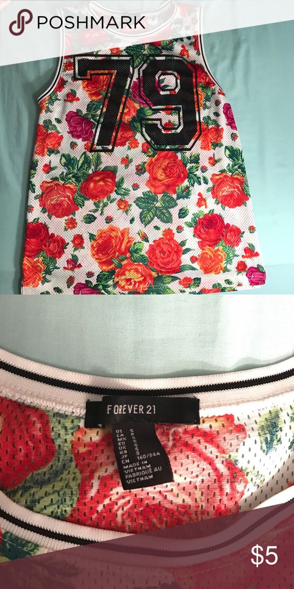 Floral Basketball Jersey! This floral basketball jersey can add flare to any outfit or be worn casually! Hardly worn and in great condition!! Forever 21 Tops Muscle Tees