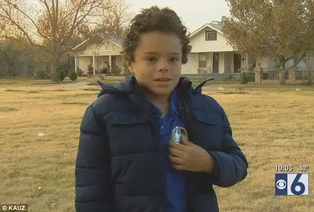Honorary cop: Smith received an honorary police member badge from the Wichita Falls Police Department, which he proudly wore to school this week