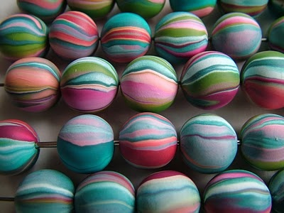 An interesting way to make striped beads with scrap polymer clay - these are pretty