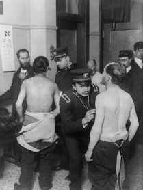 MEDICAL EXAM: Jewish immigrants being examined by doctors at Ellis Island (Library of Congress)