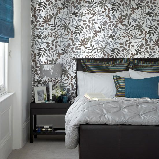 A striking monochrome print on one wall makes a great backdrop for a bed