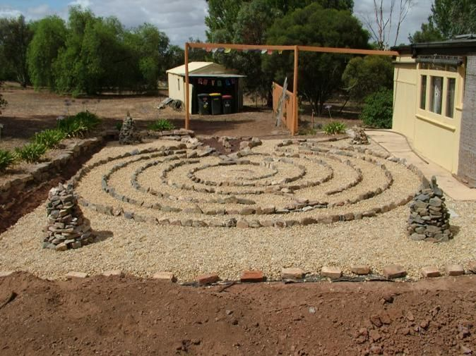 Labyrinth Designs Garden not even sure how this is paved concrete with stamped designs or individual pavers labyrinth gardencottage Labyrinth Garden Designs Crafers Rear Garden