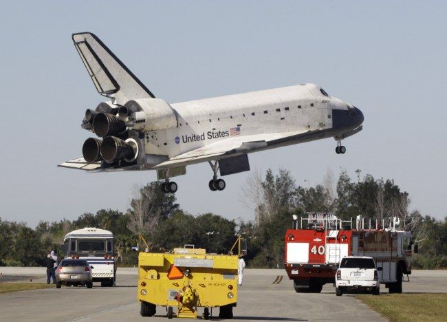 November 2009 - Space Shuttle Atlantis glides safely back into Cape Canaveral after mission to resupply the International Space Station