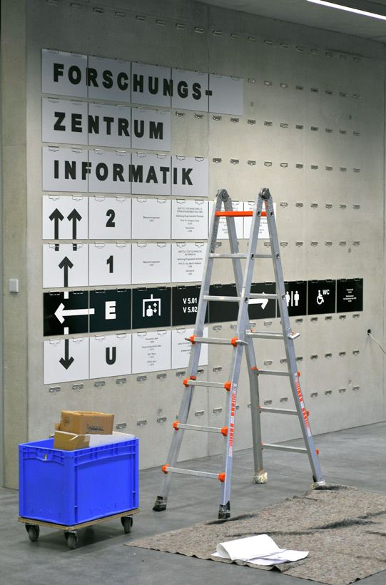Interchangeable Environmental Wayfinding Installation using clipboard clips embedded in concrete wall