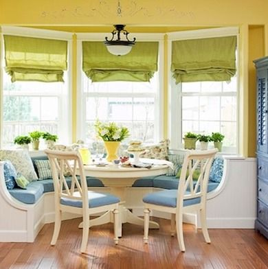 Bay windows are traditional sites for banquette seating, and a semicircular design makes practical, elegant use of this sunny space. Two side chairs increase the table's flexibility and capacity.