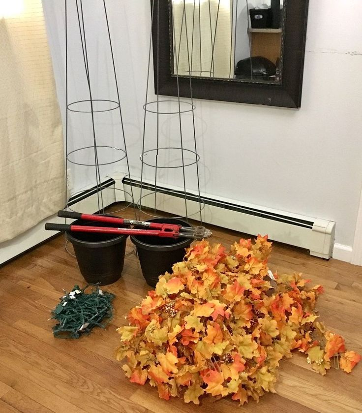 She brought in 2 tomato cages for this gorgeous fall fireplace idea