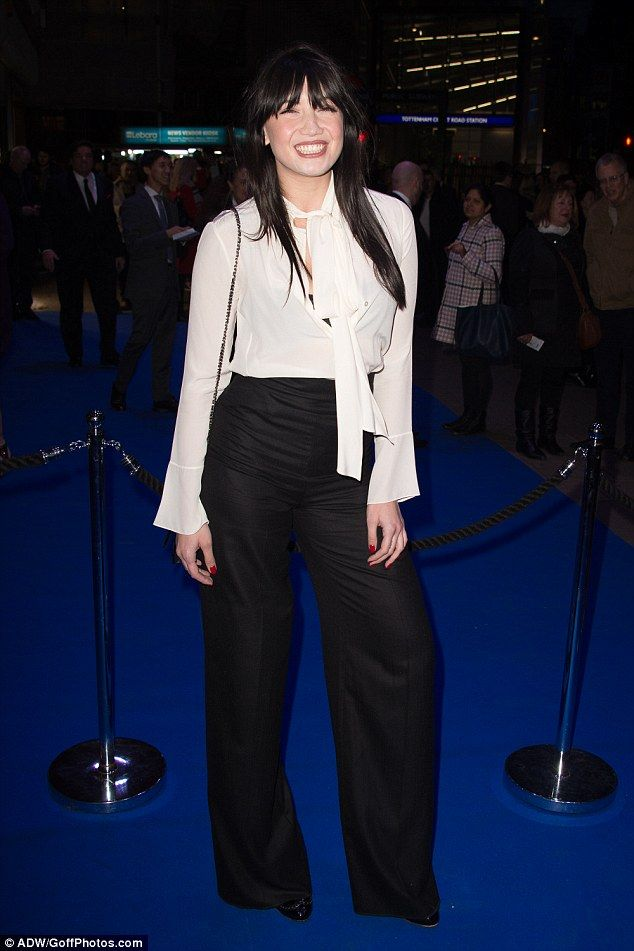 Daisy Lowe wears a black bra under a bright white pussybow blouse #dailymail