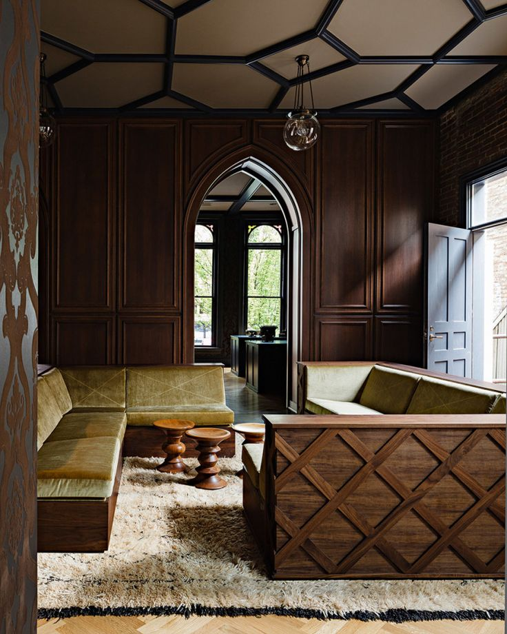 A Beautiful Gothic Styled Office Incredible Design Element Is The Arched Wood Paneled Wall Which Serves As Storage Space And Also Separates