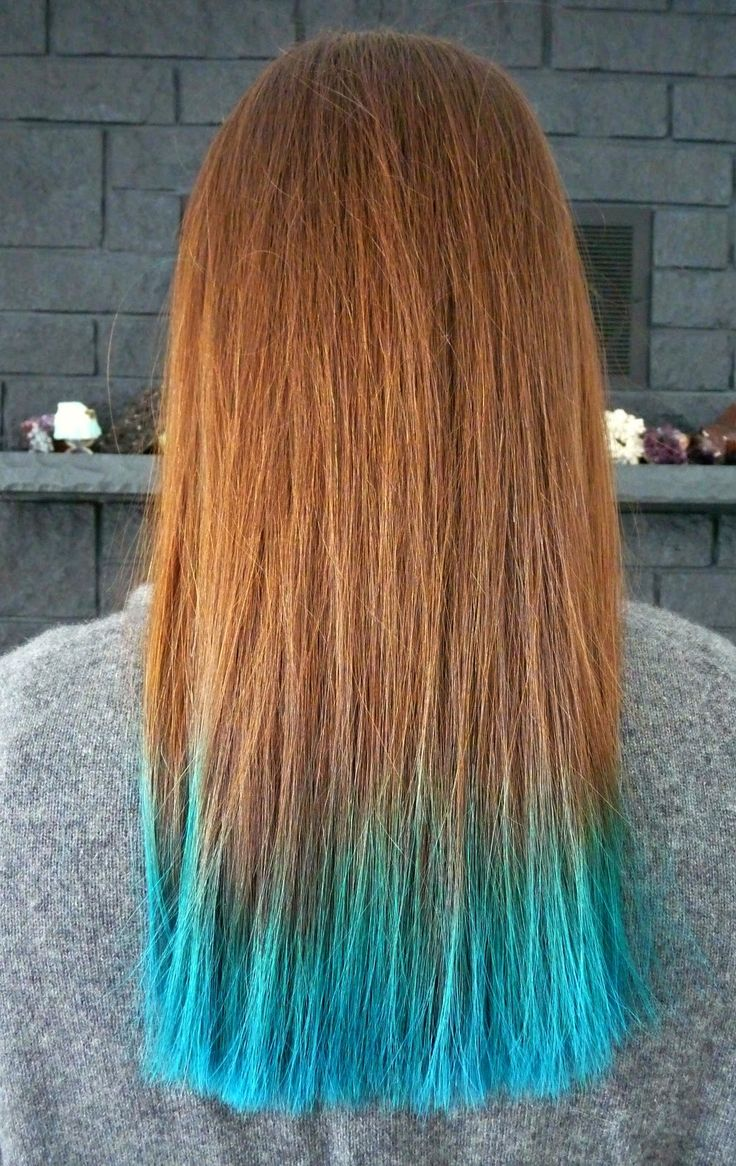 FAQ about dyeing hair a bright teal: how to get hair a bright colour, how fast does bright hair dye fade, does mermaid hair rub off on clothes, and more questions answers plus photos of brunette hair with dip dyed teal ends.