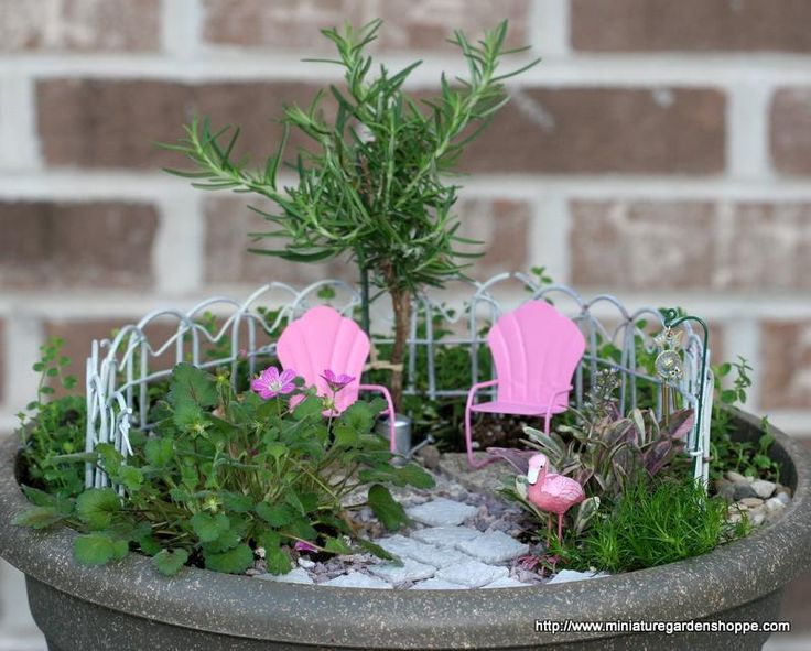 miniature garden with fenced in patio - vintage feel!