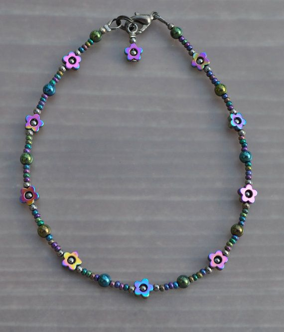 The attention to detail is apparent in this handmade anklet. This anklet is 9 1/4 inches long and made with the best quality seed beads. I can make this anklet longer or add an extension as needed upon request. If you would like a bracelet in this style let me know. You can request a hand made gift bag at no charge. This anklet features iridescent Hemalyke flower bead frames paired with gunmetal and Czech glass beads.
