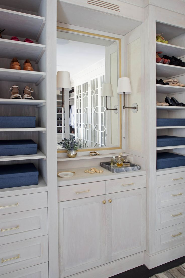Light gray closet with mirrored make up vanity cabinets transitional - White Walk In Closet With Gold Trimmed Mirror The Drawers And Cabinets In The Walk In Closet Are Dressed Up With Gold Metal Knobs And Pulls