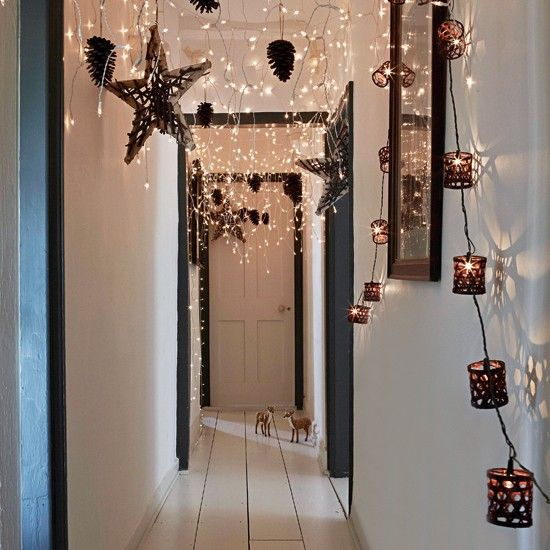 Christmas lights in the hallway. Would need to either make the strands shorter or put them to the sides so we're not hitting them with our heads all the time.